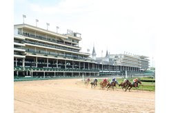 Horses race around the first turn in front of an empty Churchill Downs