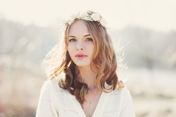girl with floral wreath on her head