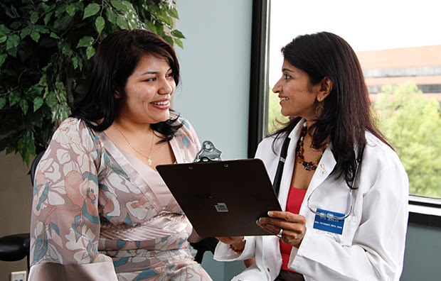 A young woman consulting with a doctor.