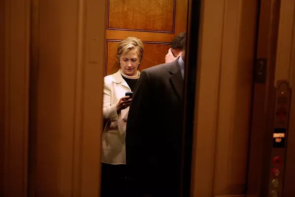 Hillary Clinton checks her Blackberry in 2009.