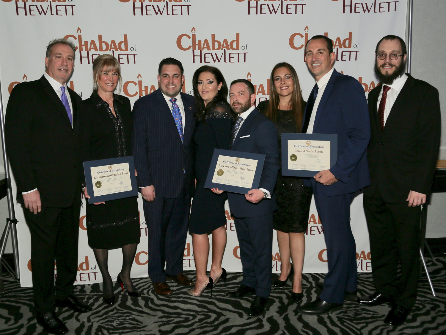 Town of Hempstead Councilman Anthony D'Esposito presented certificates of recognition to the Chabad of Hewlett honorees. From left were Dr. Adam and Shirley Boris, D'Esposito, Miriam and Alex Bronfman and Nataly and Ron Austin, and Rabbi Nochem Tenenboim.