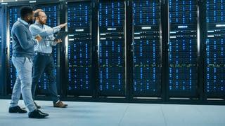 supervisor walking new employee through server room