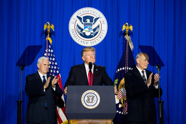 President Trump speaking at the Department of Homeland Security with Vice President Mike Pence, left, and the department secretary, John F. Kelly, on Wednesday.
