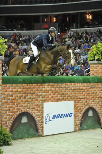 Uraya & Charlie Jayne jumping last year's Puissance wall