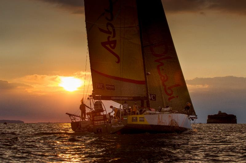 Approaching the entrance to the Solent_ Azzam is backlit by a stunning sunset Abu Dhabi Ocean Racing - Ian Roman.jpg