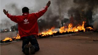 A protester guards a road block in Brasilia