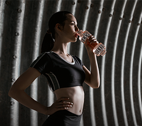 Free Photo: Young woman in sportive wear drinking water in tunnel– stock image</p><p>
