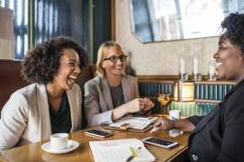 Women at Table Laughing