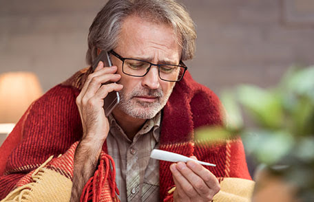 Man looking at thermometer