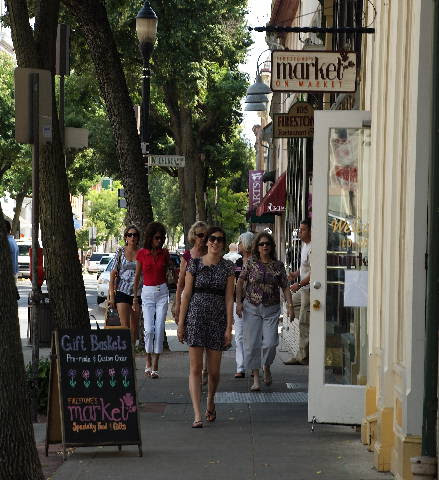 Visitors walk downtown