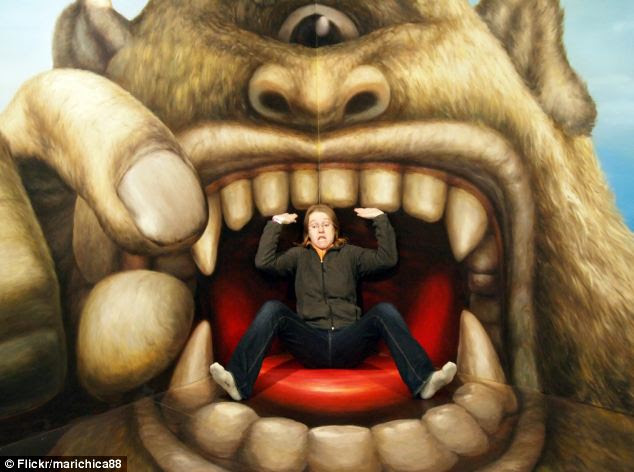 Sitting inside a monster's mouth, catching money falling from a truck and even getting peed on are all possible at the exhibition