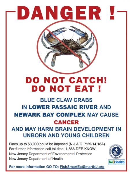"A sign reading ""Danger, do not eat, do not catch blue crab ..."""