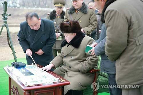 North Korean leader Kim Jong-un supervises a simulated atmospheric re-entry of a ballistic missile in this photo published in the North's Rodong Sinmun newspaper on March 15, 2016. For Use Only in the Republic of Korea. No Redistribution. (Yonhap)
