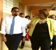 John King alongside female school official