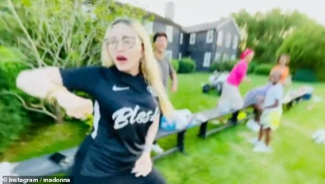 Cheering him on:The singer, 62, who was also joined by her daughters Mercy, 15, Estere and Stelle, both eight, was seen dancing on the side of the pitch after David scored on Sunday