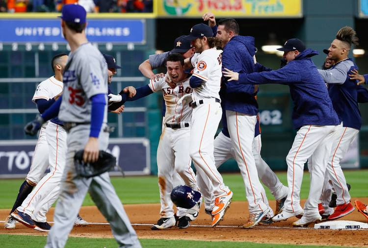 Alex Bregman of the Houston Astros celebrates with teammates after hitting a game-winning single during Game 5 of the World Series. (Jamie Squire/Getty Images)