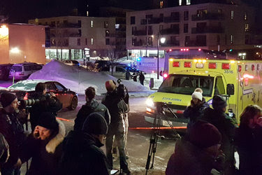 Emergency workers at the scene of a fatal shooting at the Quebec City Islamic Cultural Center in Quebec City, Canada, on Sunday.