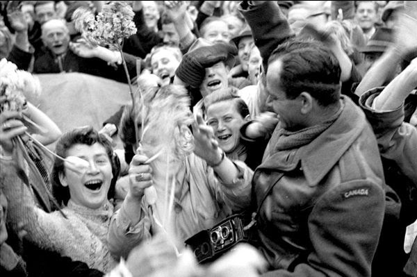 Dutch citizens celebrate liberation with a Canadian soldier.