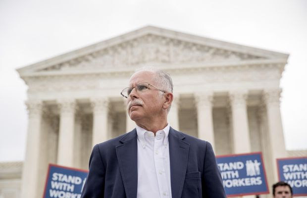 Plaintiff Mark Janus stands outside the Supreme Court after the court rules in a setback for organized labor that states can't force government workers to pay union fees, Wednesday, June 27, 2018, in Washington. (AP Photo/Andrew Harnik)