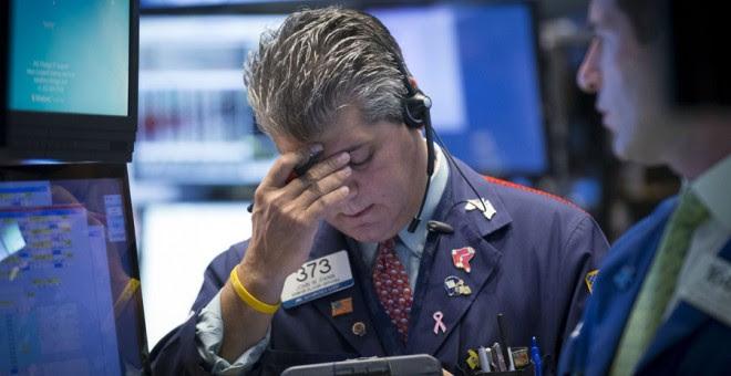 Brókers en Wall Street este lunes. REUTERS/Brendan McDermid