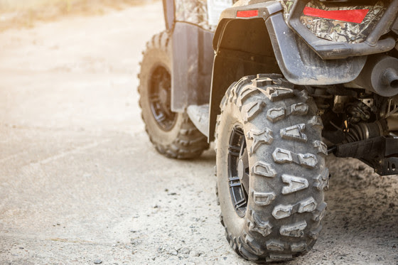 close up of dirty wheel on ATV