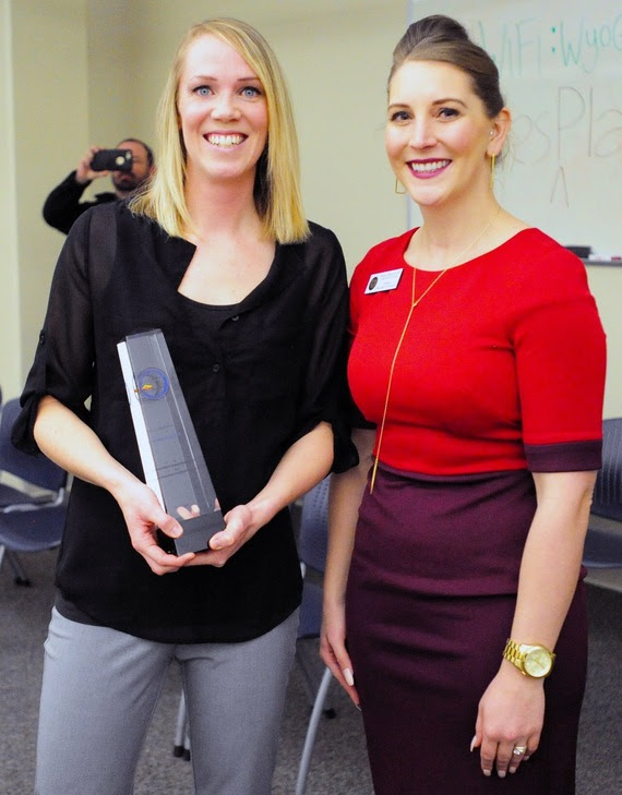 Milken Educator Award winner Shannon Hill holds her award shortly after receiving it from WDE Chief Policy Officer Megan Degenfelder.