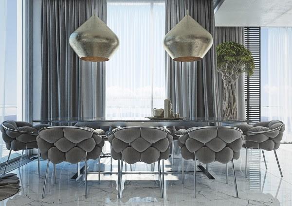 Άστραφταν φωτιστικά χρυσό φως στην τραπεζαρία, σε συνδυασμό με τη ζεστή γκρι καρέκλες, κάνουν αυτό το διαμέρισμα κατάλληλο για ένα δείπνο κόμμα του μέλλοντος.