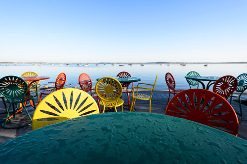 The iconic Memorial Union Terrace chairs after a rain shower