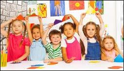 The figure above is a photograph showing kindergarten children.