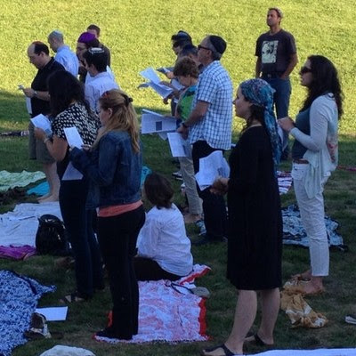 people praying in a park