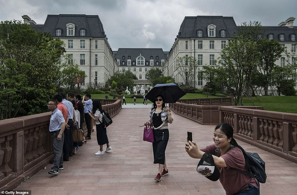 Inspired by pictures and footage of the Huawei town, young people are now flocking to see the glamours office and some say they can 'travel across Europe in one day in Huawei'