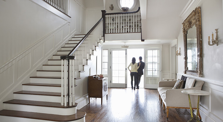 2020 Luxury Market Forecast | MyKCM - Open Stairwell with Couple in the Foyer