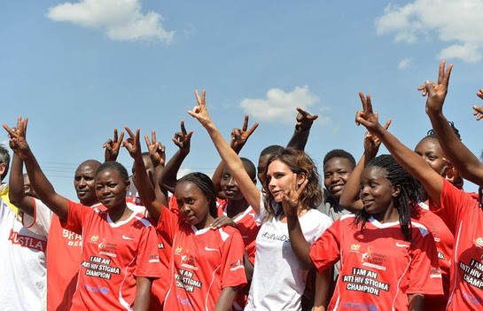 Victoria Beckham with the girls team at the launch of the national football campaign Maisha Kick Out HIV Stigma