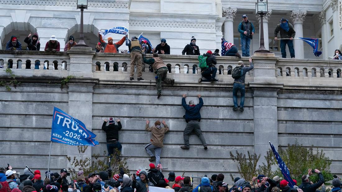 Right wing extremists scale US Capitol wall like zombies in a scene from World War Z