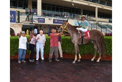 Trainer Jerry Bozzo (center) with Cotton Tooyah in the winner's circle at Gulfstream Park