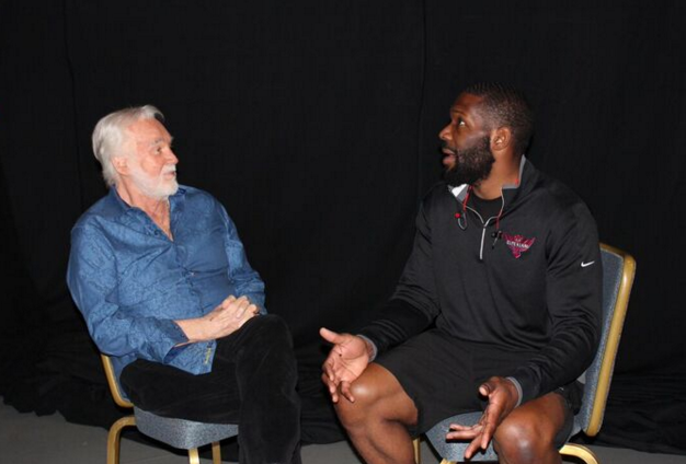 """Bryant Jennings - VERONA, NEW YORK (December 17, 2015) - After quoting """"The Gambler"""" during the Bryant Jennings vs. Luis Ortiz, media conference call on Thursday, Dec. 3, Bryant """"By-By"""" Jennings had the opportunity to meet Kenny Rogers today at Turning Stone Resort Casino. As luck would have it, Mr. Rogers is on tour and in town for one night only during the fight week of one of the most anticipated heavyweight matchups in the sport. Click HERE for photos of their encounter and a recording and transcript of the media conference call.  Quote from media conference call:  Q: Now, I mean you've got a body that looks like it was chiseled out of marble, you're a great athlete, but do you worry about maybe leaving it in the ring and overtraining ahead of the fight?  BRYANT JENNINGS: No. That's why I'm with top-tier trainers and things like that; we know 'when to hold'em, we know when to fold'em', we know when to pick it up and things like that, and that's what makes the trainers great.     Tickets for the Dec. 19 HBO Boxing After Dark and HBO Latino Boxing event start at $25, $35 and $60 for ringside seats plus applicable fees and are available at the Turning Stone Resort Box Office by calling 315-361-7469 or online at Ticketmaster (www.ticketmaster.com).  Jennings vs. Ortizis a 12-round heavyweight bout fight for the WBA Interim Heavyweight Title presented by Golden Boy Promotions in association with Gary Shaw Productions and is sponsored by Corona, Mexico - Live It to Belive It! and Carmelita Chorizo. Walters vs. Sosa is a 10-round junior lightweight bout presented by Top Rank in association with Peltz Boxing Promotions and Warriors Boxing Promotions. Doors open at 6:00 p.m. ET and first fight begins at 6:05 p.m. ET, and the HBO Boxing After Dark telecast begins live at 10:15 p.m. ET/PT."""