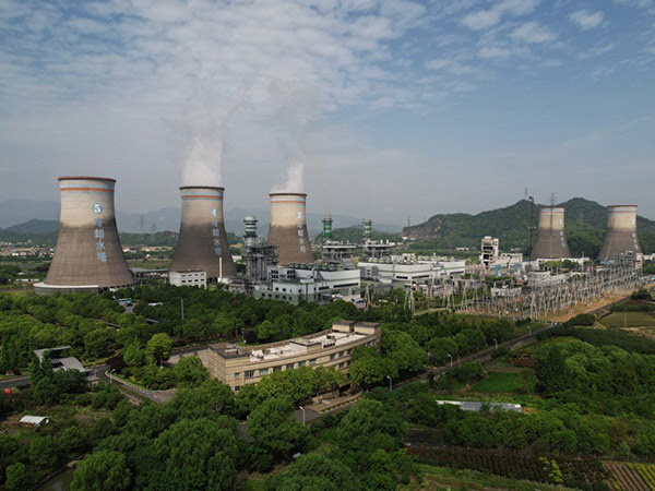 Steam billows out of chimneys of a coal-fired power plant in Hangzhou in east China's Zhejiang province.