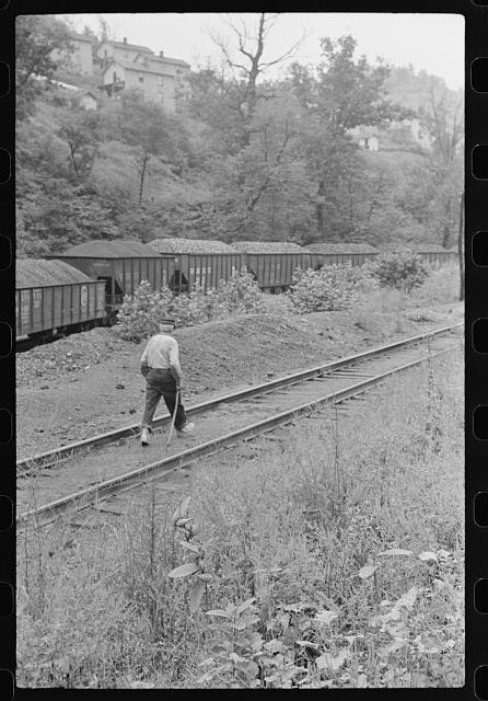 Old man, Hungarian, with cane, going home after work along tracks, Pursglove, Scotts Run, West Virginia