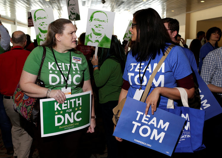 Supporters of Keith Ellison and Tom Perez engage with each other during the DNC event. (Joshua Roberts/Reuters)</p>
