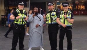 UK police officers make ISIS one-finger salute