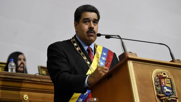"Venezuelan President Nicolas Maduro (R) presents the annual report before the opposition controlled National Assembly near the head of the Venezuelan Supreme Court Gladys Maria Gutierrez (C) in Caracas on January 15, 2016. Venezuela's President Nicolas Maduro decreed a two-month state of ""economic emergency"" Friday, seizing the initiative ahead of a key showdown in his standoff with the opposition in the oil-rich nation. Venezuela's economy contracted 4.5 percent in the first nine months of 2015, the central bank said Friday, the first official data in more than a year on the magnitude of the South American oil giant's recession. AFP PHOTO / JUAN BARRETOJUAN BARRETO/AFP/Getty Images"