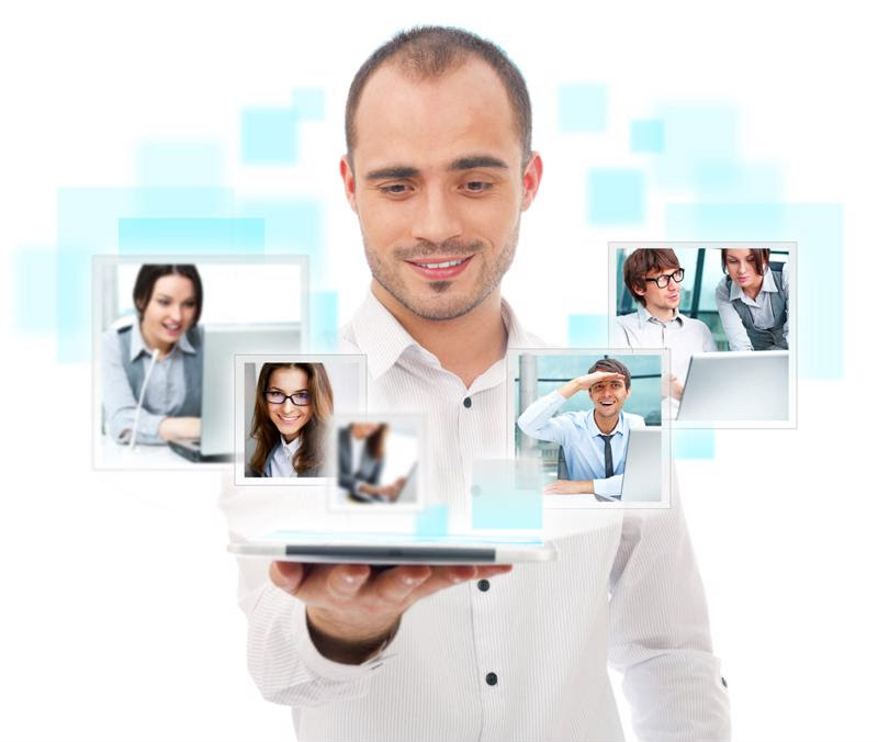 A manager is surrounded by images of his virtual team.
