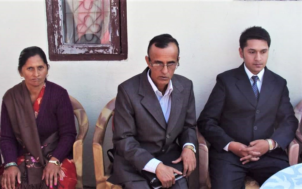 Pastor Govinda Dhakal, between wife Saraswoti Dhakal and son Prabhushanta. (Morning Star News)