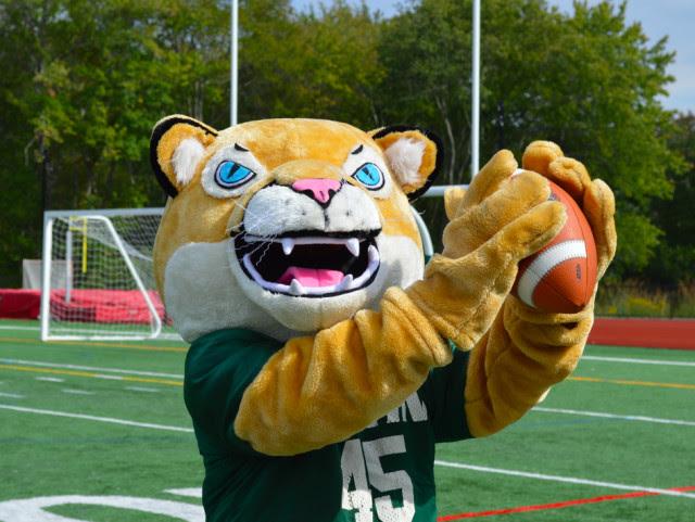 Austin Prep cougar mascot with a football
