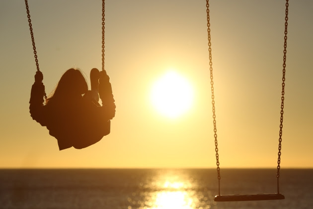 bigstock-Lonely-Woman-Silhouette-Swingi-88723208.jpg