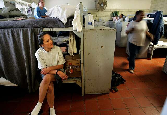 Lydia Alvarez sits on her bunk bed, which she had to cover with a prison-issue blanket. Her bed is in a converted day room shared by 38 women at the California Institution for Women in Corona, where the inmate population of 1,500 is at an all-time high.