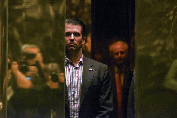 Donald Trump Jr. rides the elevator at Trump Tower in New York City during the transition. (Stephanie Keith/Reuters)