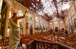 Officials inspect the damaged St. Sebastian's Church after multiple explosions targeting churches and hotels across Sri Lanka on April 21, 2019 in Negombo, north of Colombo, Sri Lanka