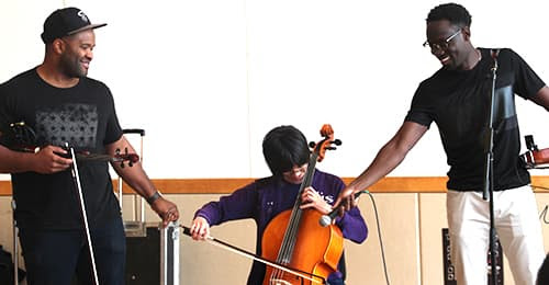 Black Violin working with a student.