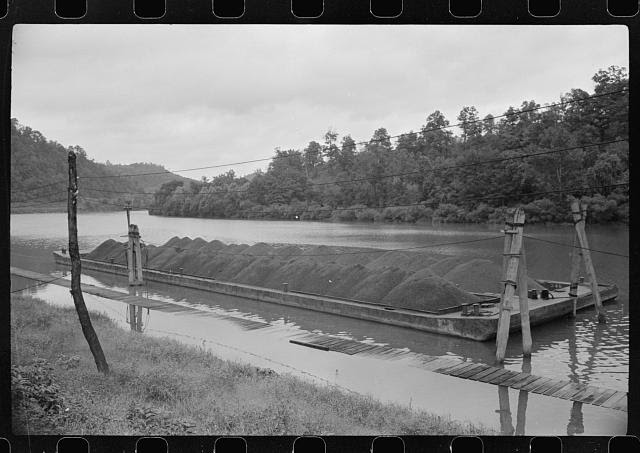 Coal barge on river, Scotts Run, West Virginia